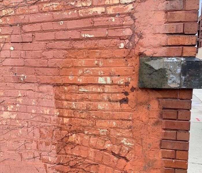 Brick wall cleaned of the spray paint